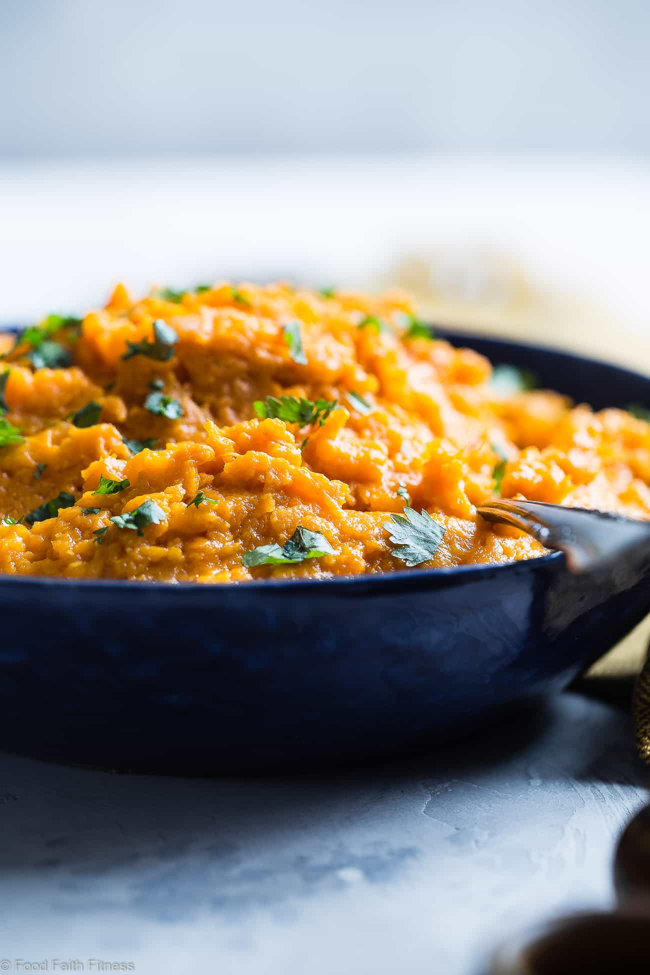 Coconut Curry Mashed Sweet Potatoes - A sweet and spicy spin on a holiday classic!  So creamy you will never believe they are dairy, grain and gluten free and paleo/vegan/whole30 compliant! | Foodfaithfitness.com | @FoodFaithFit