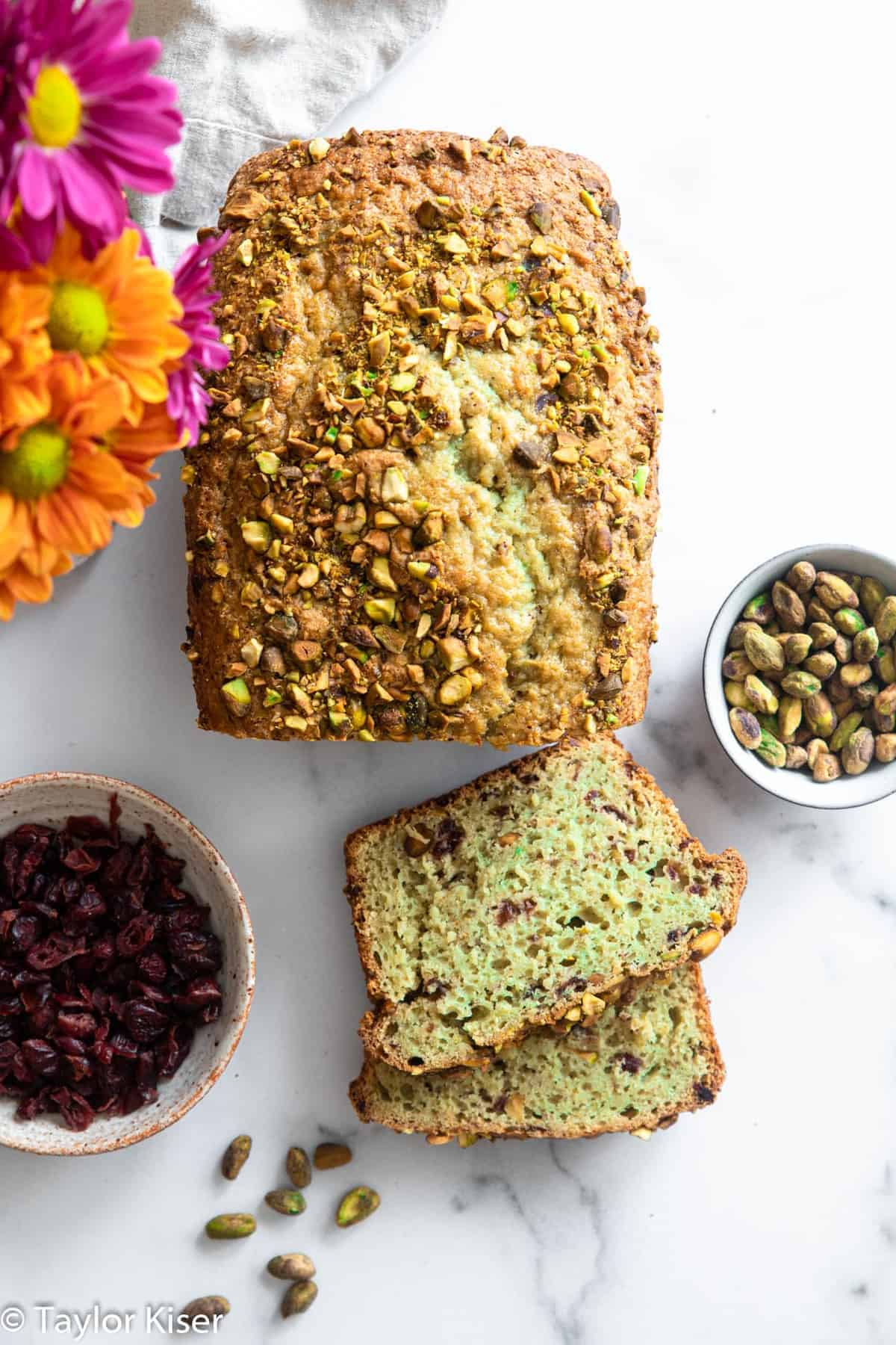 pistachio bread sliced on a table with flowers