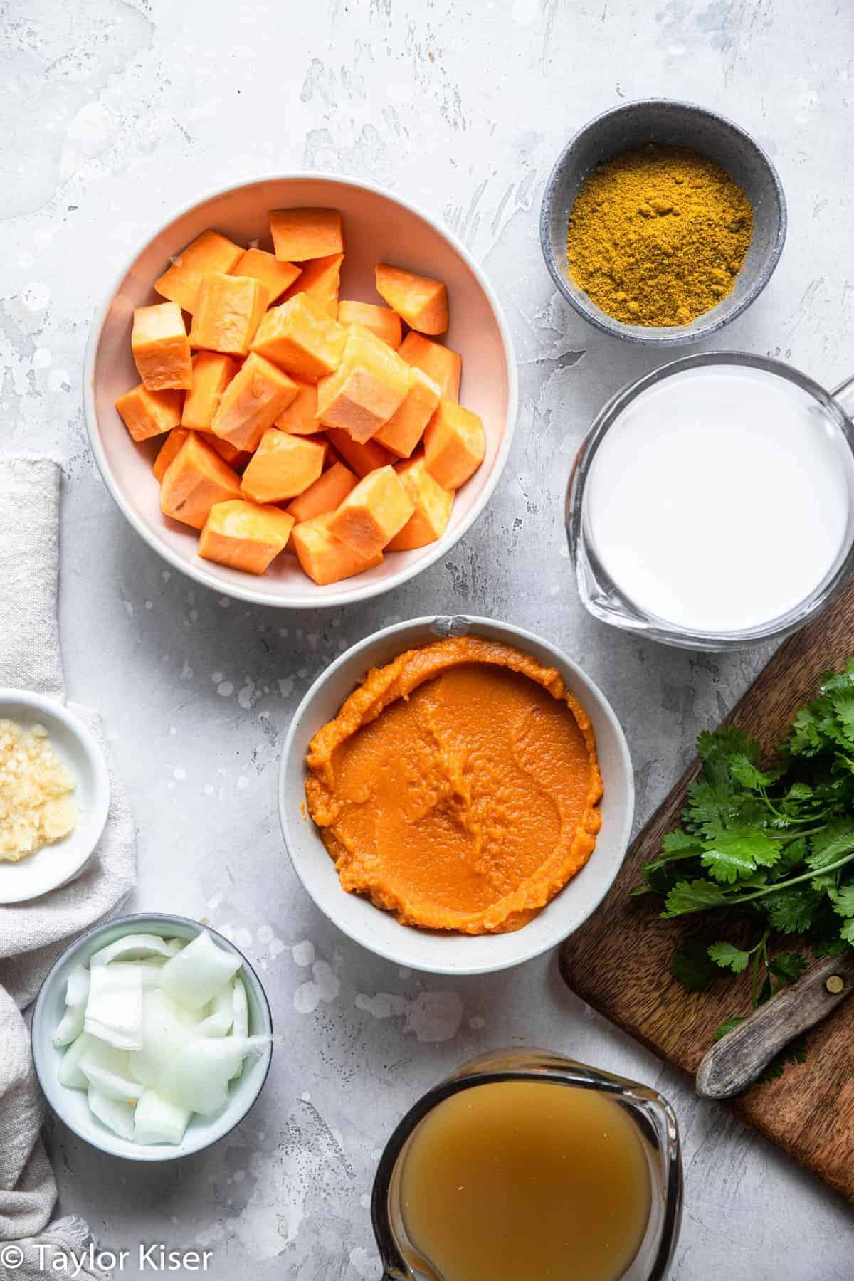 Ingredients to make a pumpkin curry recipe on a table