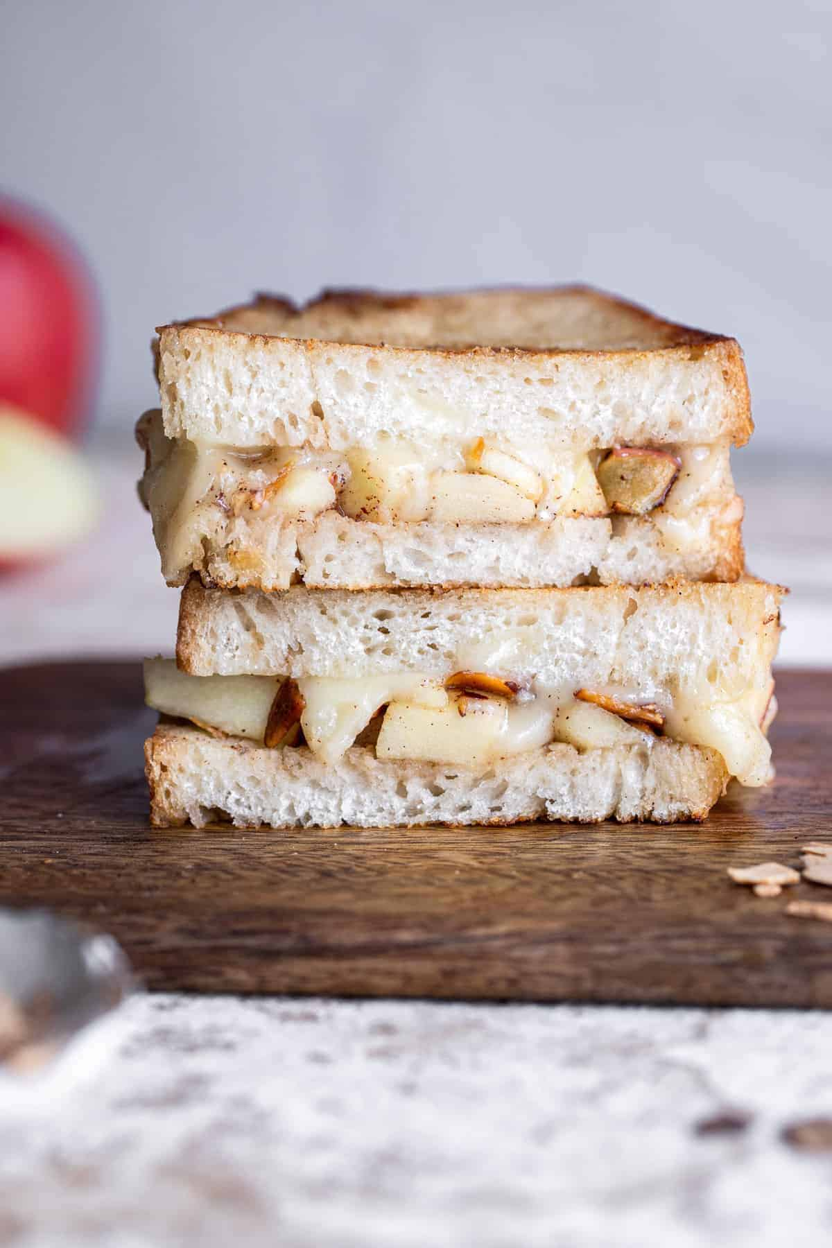 two halves of a brie grilled cheese stacked on top of each other