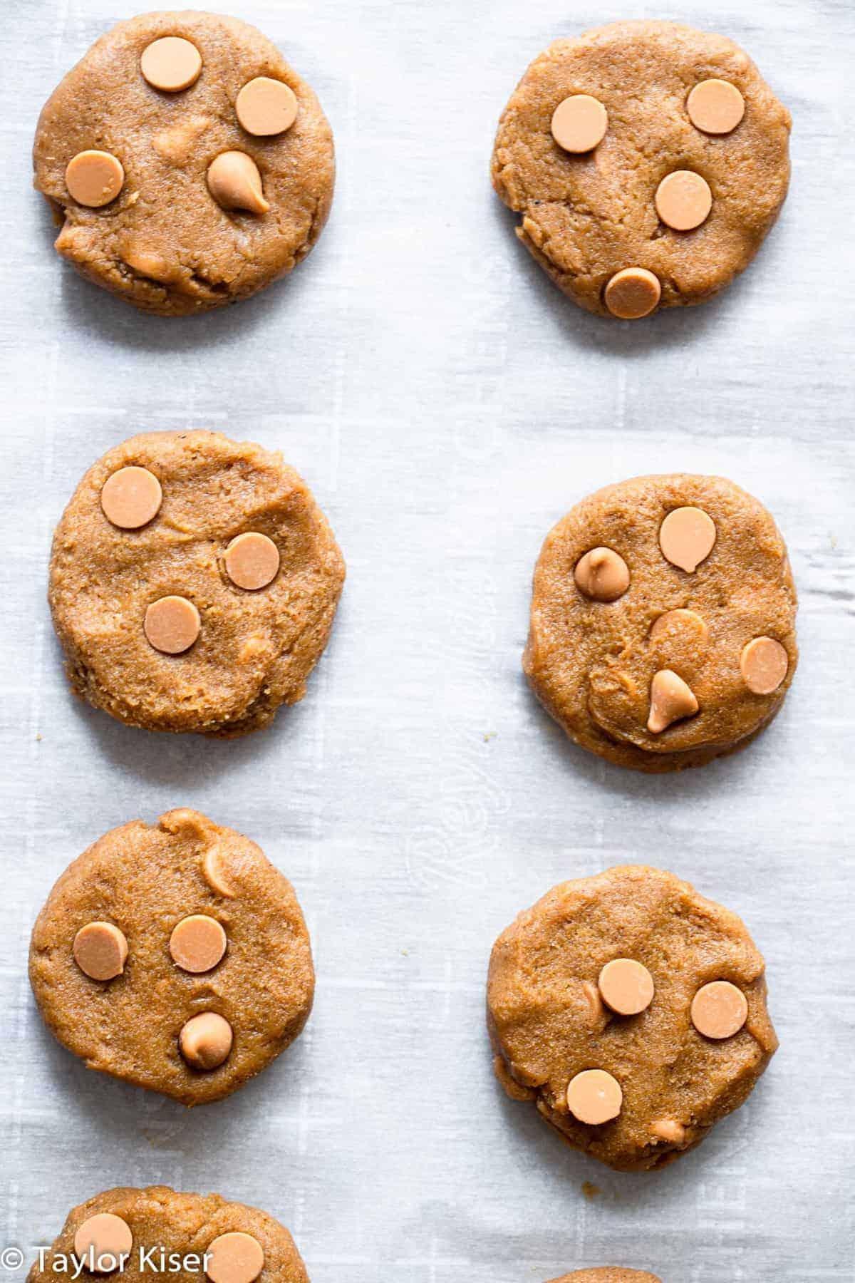 unbaked healthy pumpkin cookies on a baking sheet