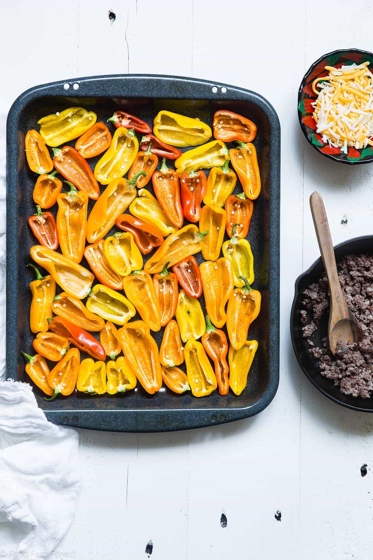 making mini bell pepper nachos. Recipe on Foodfaithfitness.com
