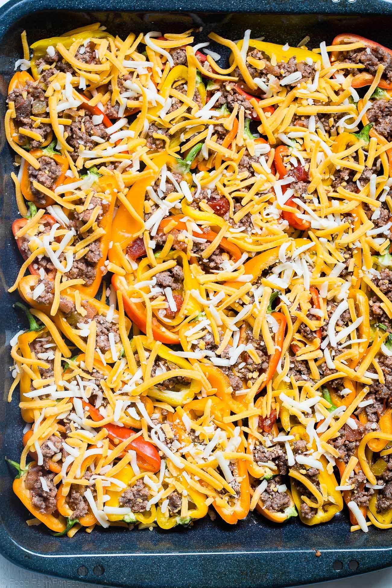 Putting cheese on mini bell pepper nachos. Recipe on Foodfaithfitness.com