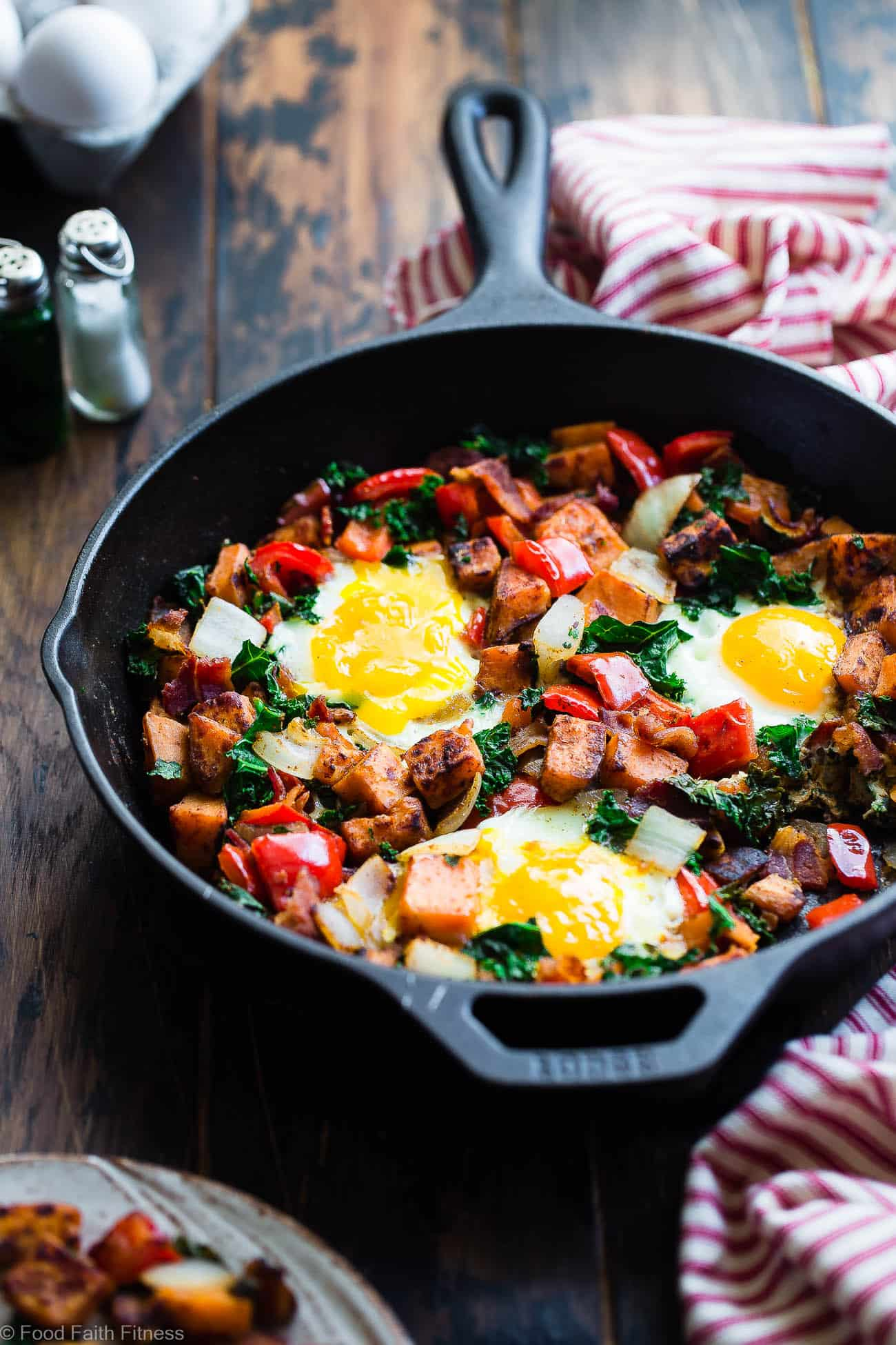 Healthy Paleo Sweet Potato Breakfast Hash with Bacon -This 30 minute, paleo friendly sweet potato hash with eggs makes a quick, delicious and healthy breakfast that is gluten/grain/dairy/sugar free and only 310 calories!| #Foodfaithfitness.com | #Paleo #Glutenfree #Whole30 #Healthy #Breakfast