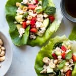 Low Carb Chicken Larb Gai Lettuce Wraps - An easy, healthy twist on a classic Thai salad! They're low carb, paleo friendly and super easy to make! Great for quick weeknight dinners!   #Foodfaithfitness   #glutenfree #lowcarb #paleo #healthy #Thai