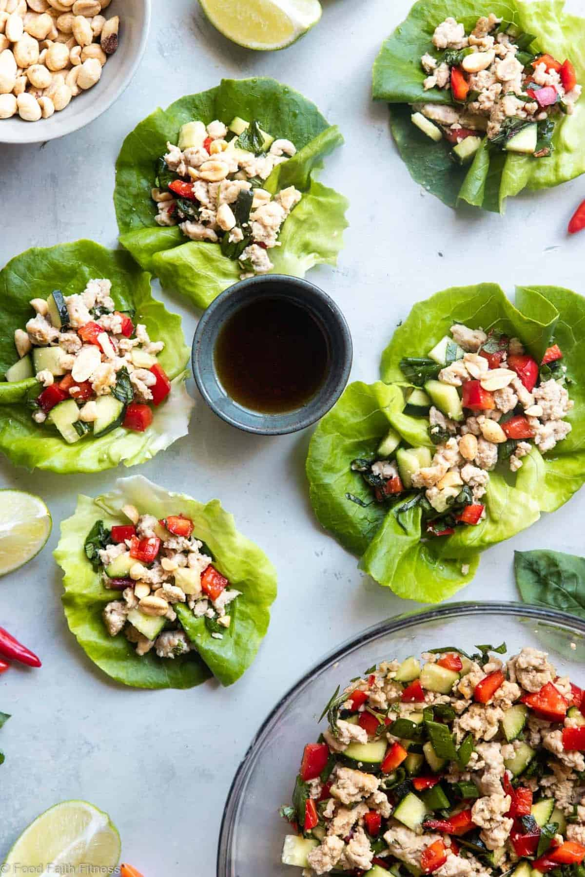 Low Carb Chicken Larb Thai Lettuce Wraps - An easy, healthy twist on a classic Thai salad! They're low carb, paleo friendly and super easy to make! Great for quick weeknight dinners!   #Foodfaithfitness   #glutenfree #lowcarb #paleo #healthy #Thai