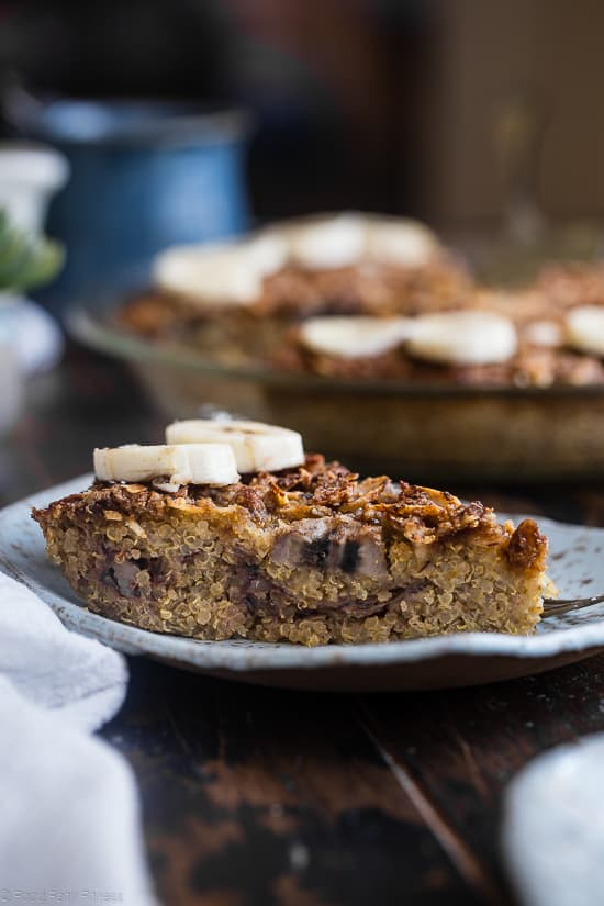 slice of quinoa breakfast bake on a plate with bananas on top
