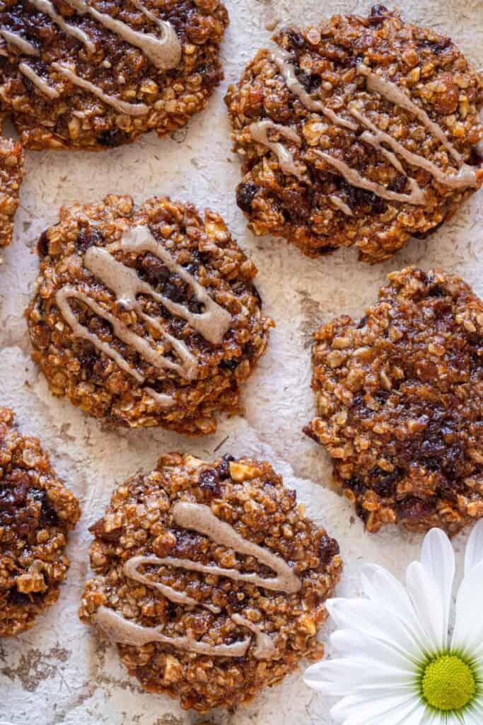 close up of sweet potato cookies with nut butter drizzle on top
