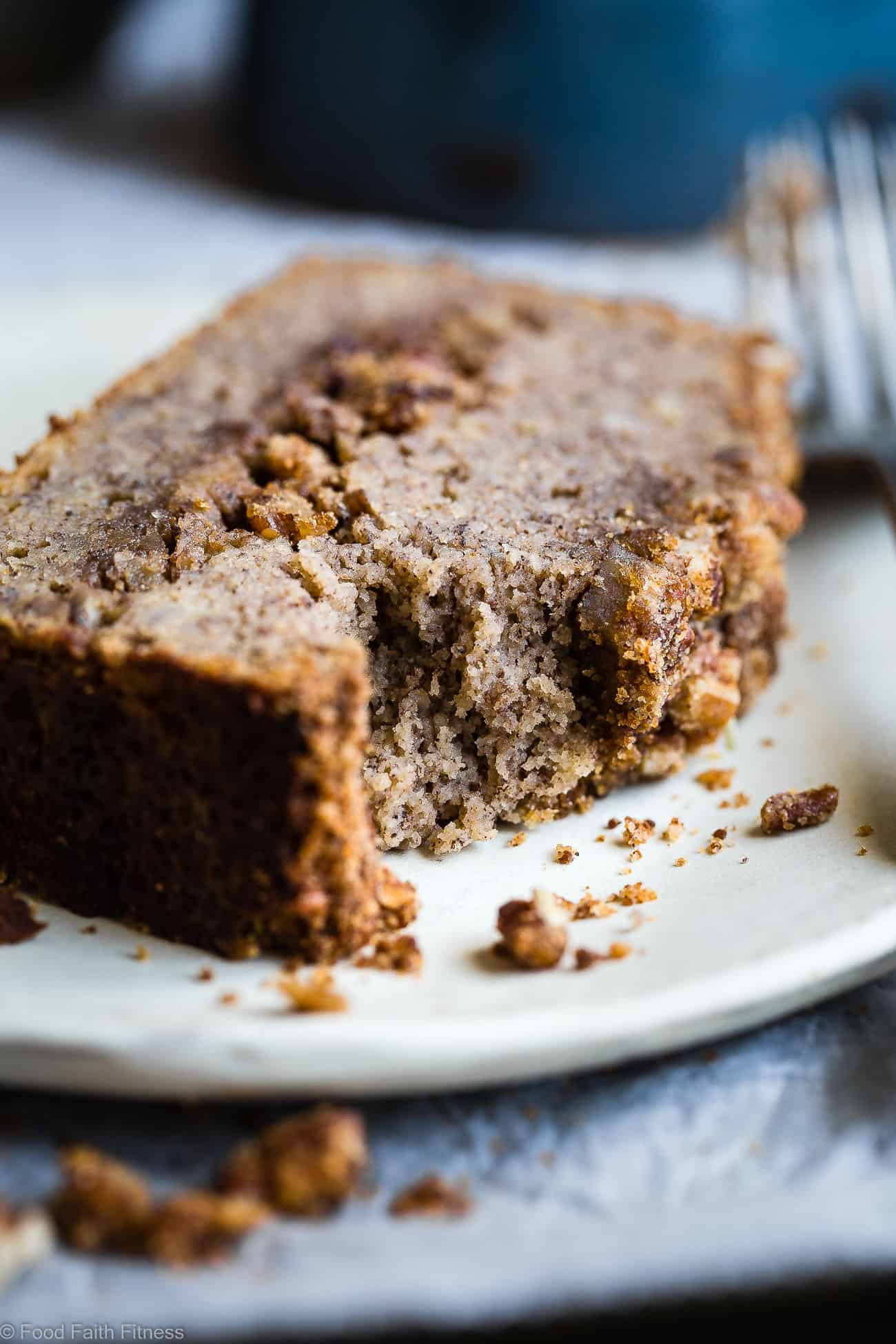 The Best Paleo Banana Bread with Pecan Streusel -This easyPaleo Coconut Flour Banana Bread is gluten/grain/dairy/refined sugar free but perfectly moist and sweet! The pecan topping MAKES it so addicting and you'll never know it's healthy! | Foodfaithfitness.com | @FoodFaithFit