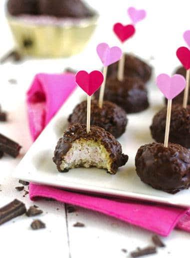 Raspberry Cheesecake Stuffed Coconut Quinoa Bites with Dark Chocolate Glaze {Gluten free} - Food Faith Fitness