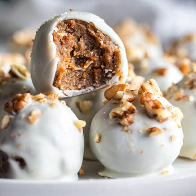 Carrot Cake Truffles on a plate with a bite taken out of one
