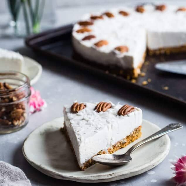 Gluten Free Dairy Free Carrot Cake Cheesecake - This easy cake has ahealthy carrot cake bottom and a no-bake, dairy and no sugar added cheesecake topping! Only 150 calories and perfect for Easter! | #Foodfaithfitness | #Glutenfree #Dairyfree #Sugarfree #Carrotcake #Easter