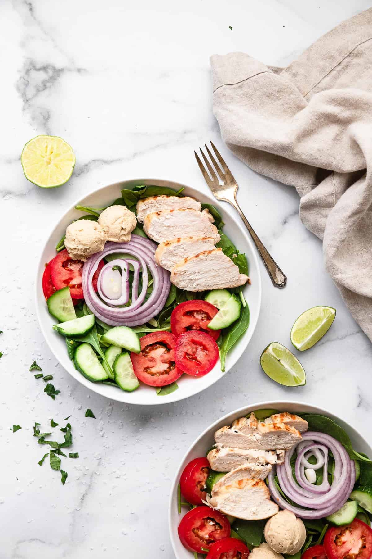 High protein salad in a bowl with chicken, tomatoes and cucumber