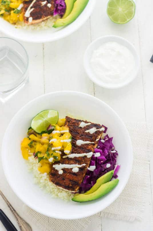 Fish Taco Bowls with Mango Salsa and Cauliflower Rice - a healthy twist on a classic! | Food Faith Fitness | #recipe #taco #glutenfree