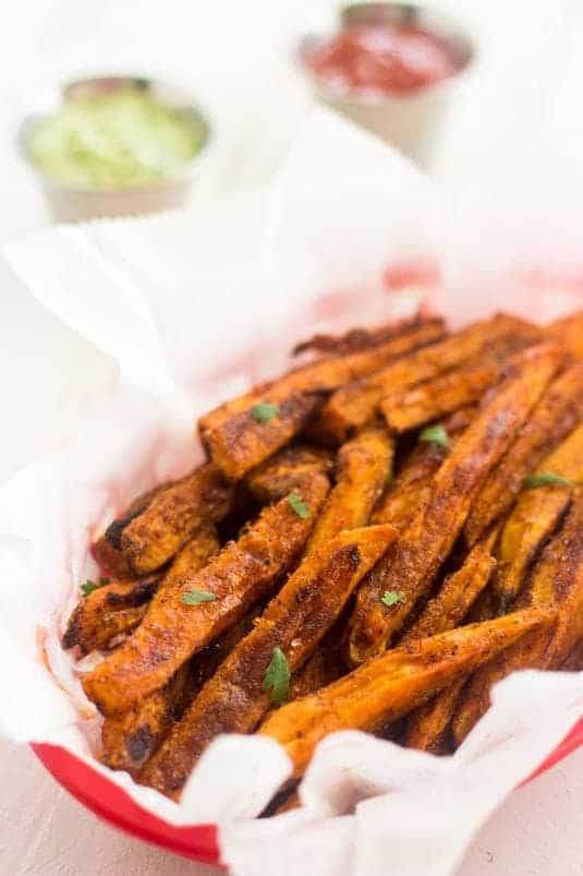 Mexican Baked Sweet Potato Fries with Avocado Cilantro Dip - Quick, healthy and crunchy, you won't miss the fried version! | Food Faith Fitness| #sweetpotato #fries #recipe