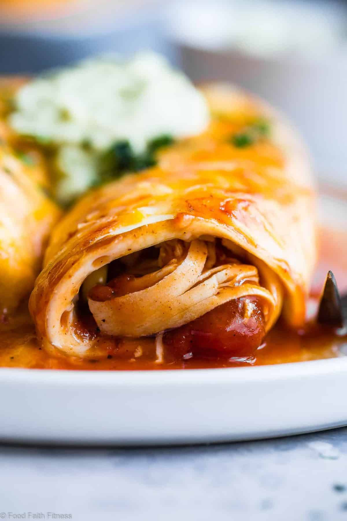 Healthy Low Carb Chicken Enchiladas - This gluten free Healthy Low Carb Chicken Enchilada Recipe uses a secret ingredient to make it low carb, protein PACKED and under 500 calories for a HUGE serving! These do NOT taste healthy and even picky eaters love them! | #Foodfaithfitness | #Lowcarb #Glutenfree #Healthy #Grainfree #Enchiladas