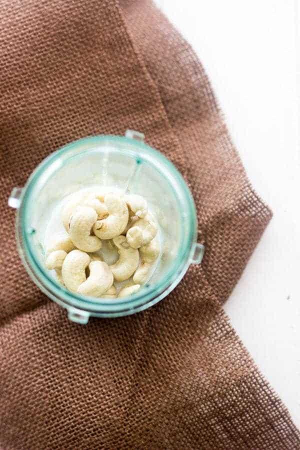 Coconut Cashew Cream Sauce - Easy, 3 ingredients and vegan! You'll never need alfredo again! | Foodfaithfitness.com | #vegan #recipe #glutenfree