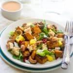 Curried Sweet Potato and Mango Salad - Sweet coconut and mango, and spicy curry roasted sweet potatoes and cashews, this salad has it all! | Foodfaithfitness.com | #glutenfree #salad #recipe