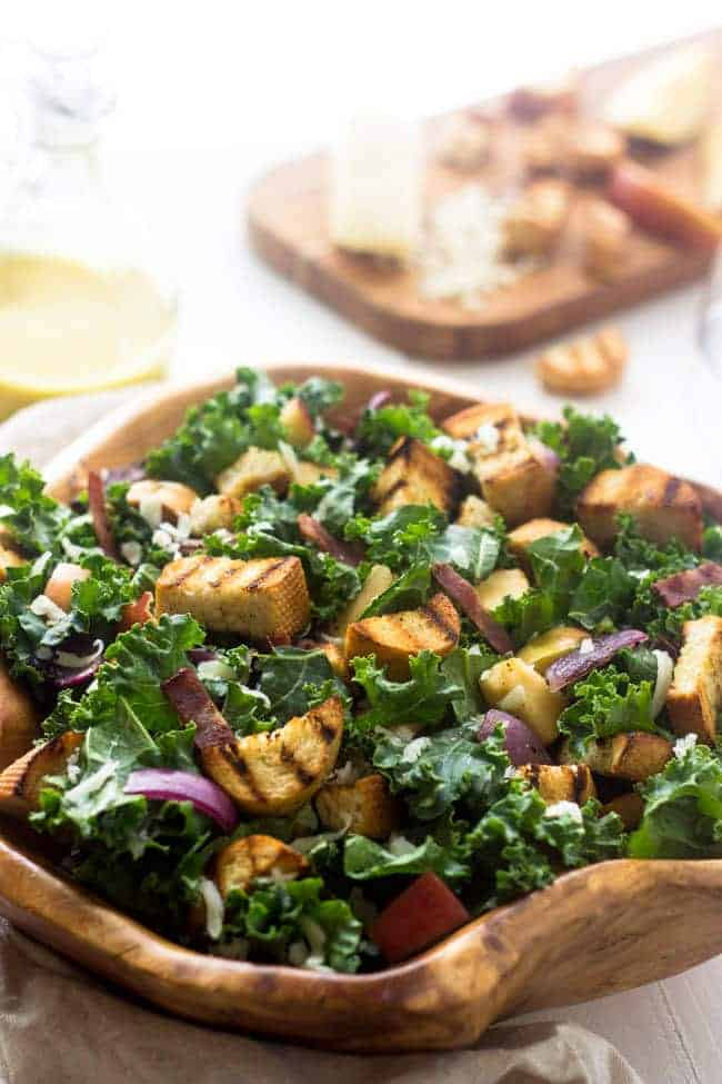 Grilled Kale Panzanella Salad - With THE BEST smokey honey mustard vinaigrette! | Foodfaithfitness.com | #salad #kale #recipe