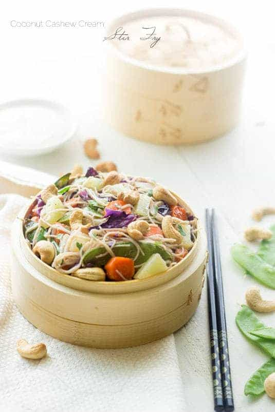 Honey Ginger Cashew Cream Stir Fry - Noodles, crunchy cashews and sweet honey ginger pineapples, this healthy meal has it all! And it's quick and easy! | Foodfaithfitness.com | #stirfry #vegetarian #recipe