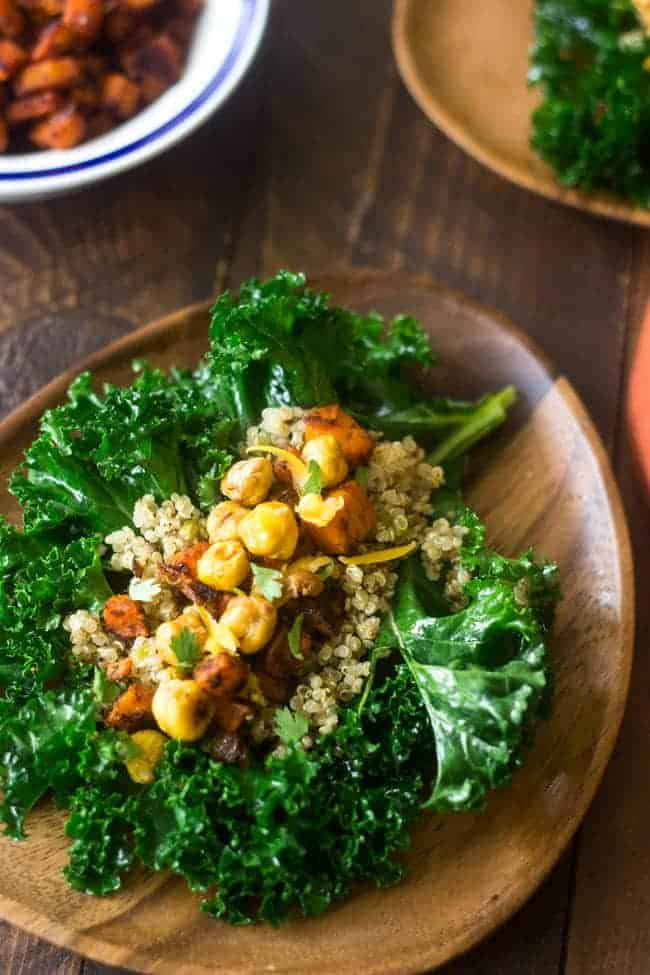 Mexican Quinoa Kale Wraps - Filled with crunchy chickpeas and sweet potatoes, these are perfect for #meatlessmonday | Foodfaithfitness.com | #kale #recipe #vegetarian
