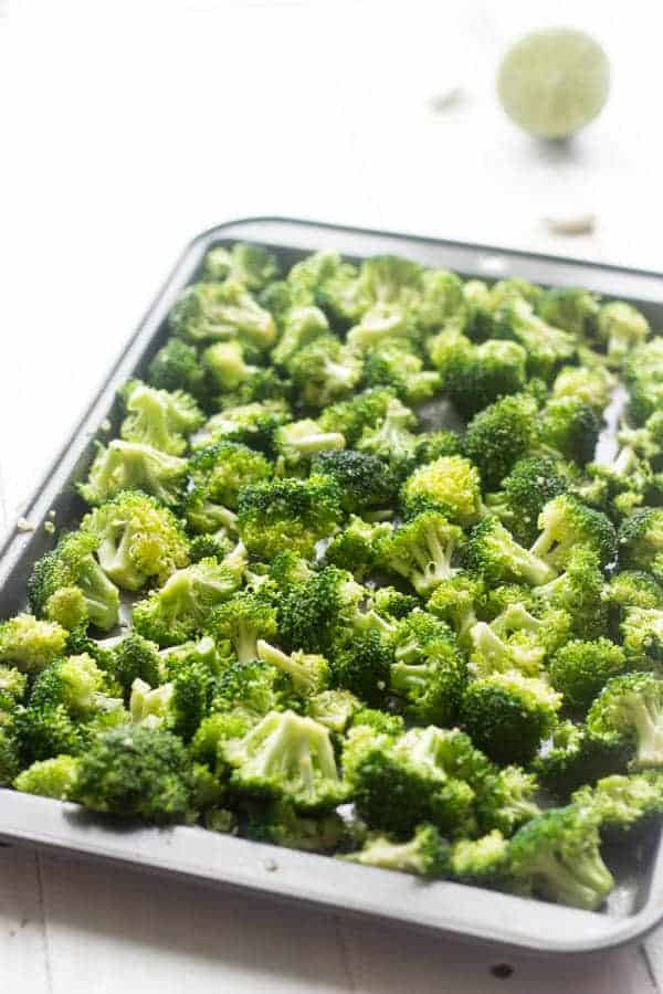 Spicy Asian Roasted Broccoli - A super simple, healthy side that your family will LOVE! | Foodfaithfitness.com | #broccoli #sidedish #recipe