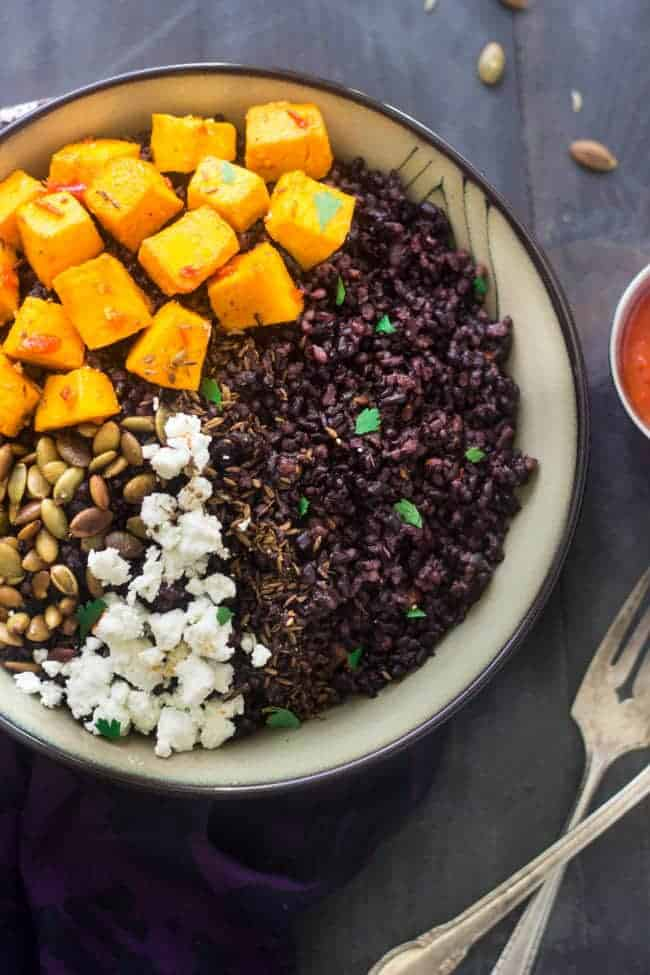 Black Rice Bowls with Roasted Pumpkin, Harissa and Goat Cheese - A unique and healthy dinner, you HAVE to try it! | Foodfaithfitness.com | #glutenfree #pumpkin #rice #recipe