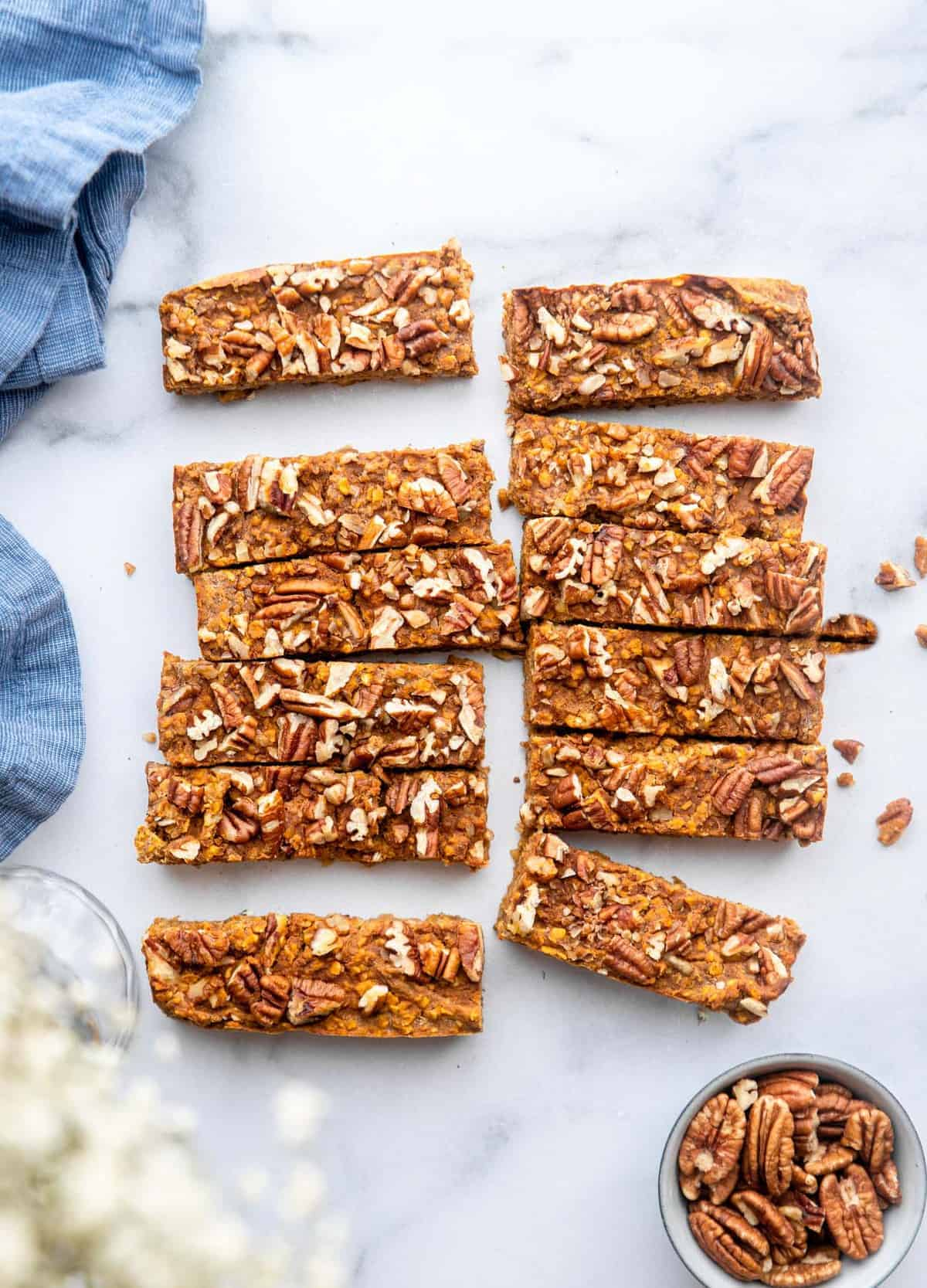 homemade pumpkin protein bars slices with pecans on top