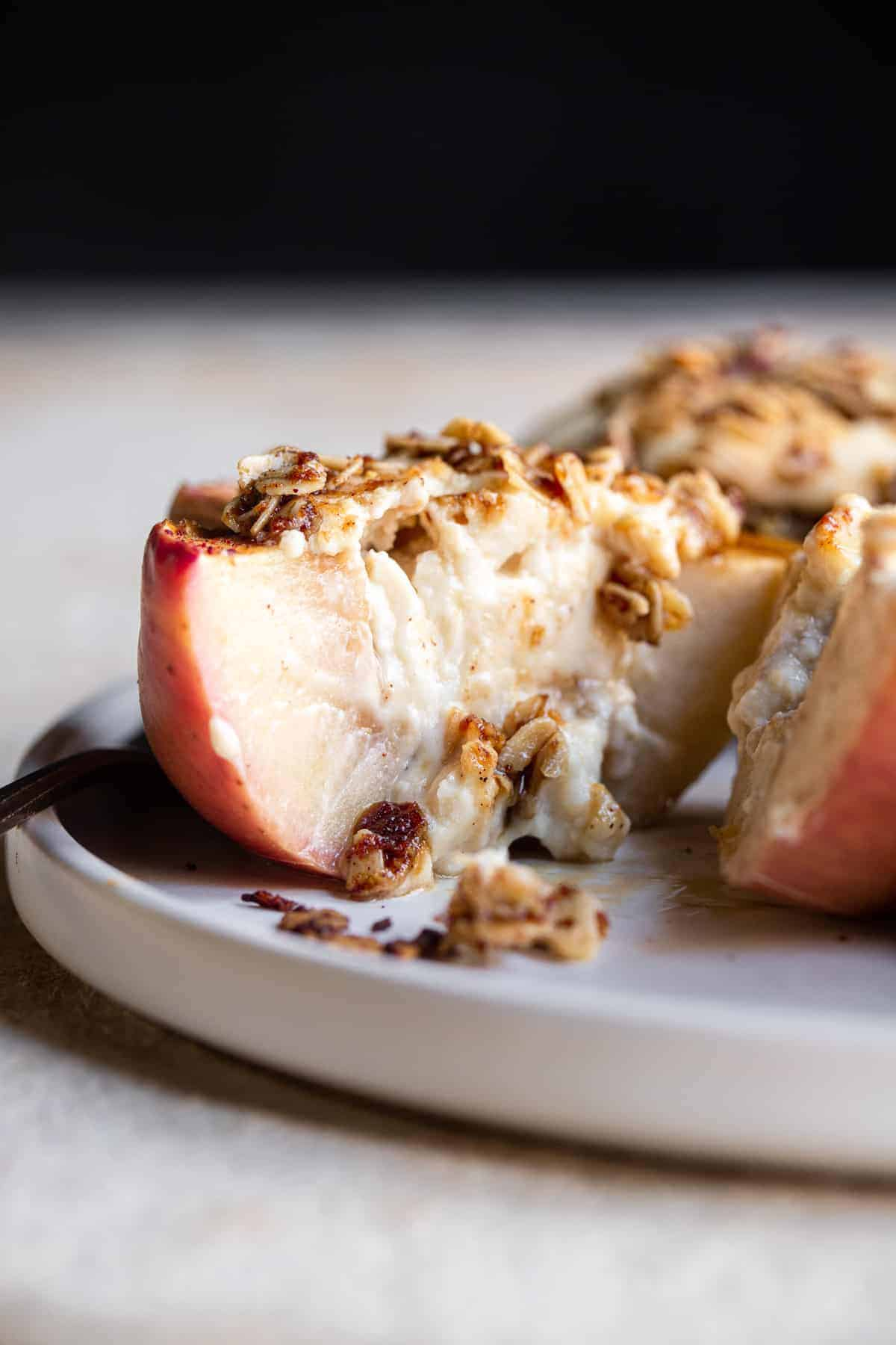 cut open Cheesecake Stuffed Apples on a plate