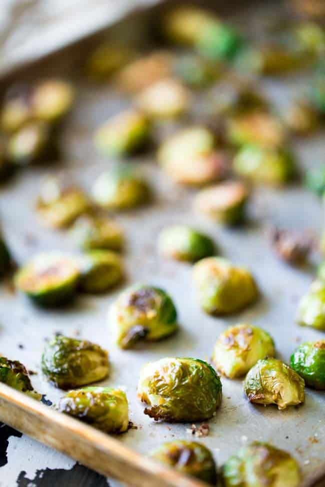 Balsamic Roasted Brussel Sprouts with Goat Cheese and Almonds - An easy side dish that my HUSBAND called addictive! | Foodfaithfitness.com | #recipe