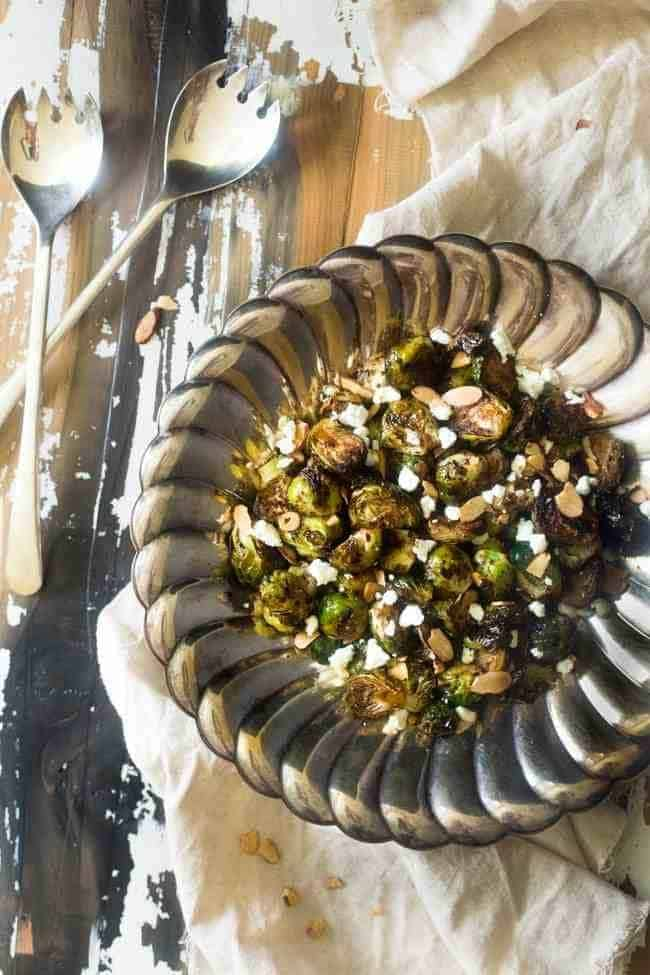 Balsamic Roasted Brussel Sprouts with Goat Cheese and Almonds - An easy side dish that my HUSBAND called addictive!   Foodfaithfitness.com   #recipe