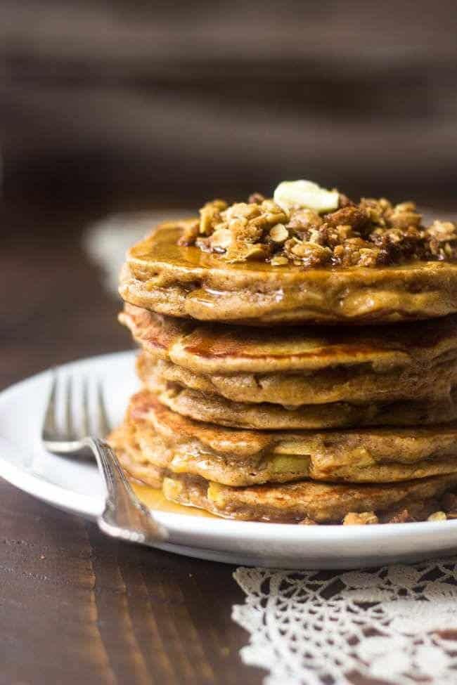 Whole Wheat Apple Crisp Pancakes - These pancakes taste like dessert for breakfast! Using Greek yogurt keeps them light, healthy and SO creamy!   Foodfaithfitness.com   #recipe