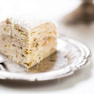 Crepe Cake with Pistachios And Coconut Cream Cheese Frosting