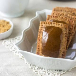 Honey Molasses Homemade Pop Tarts - These are packed with cozy spices and are made with coconut oil and whole wheat flour for quick and healthy portable breakfasts! | Foodfaithfitness.com | #recipe