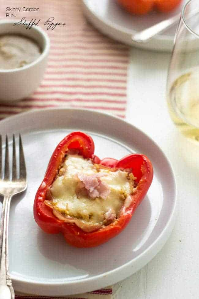 Cordon Bleu Stuffed Peppers - These healthy stuffed peppers taste just like chicken cordon bleu, bit without the carbs and calories! Healthy comfort food at it's finest! | Foodfaithfitness.com | #recipe