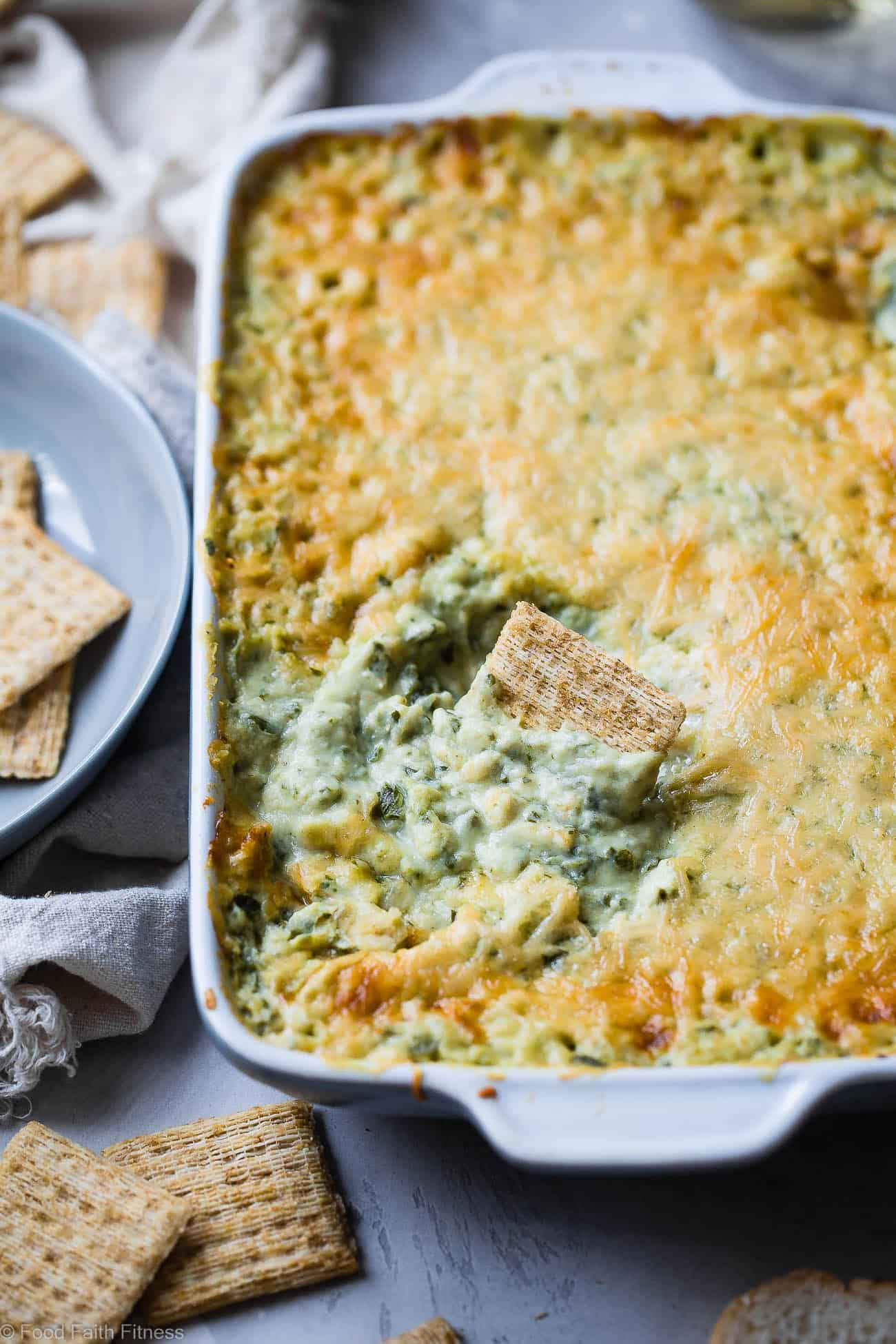 Easy Homemade Spinach Greek Yogurt Dip Recipe - This easy, cheesy, baked dip uses Greek yogurt to make it SUPER thick and creamy! It's low carb, protein packed and always a hit at parties! No one believes it's healthy! | Foodfaithfitness.com | @FoodFaithFit