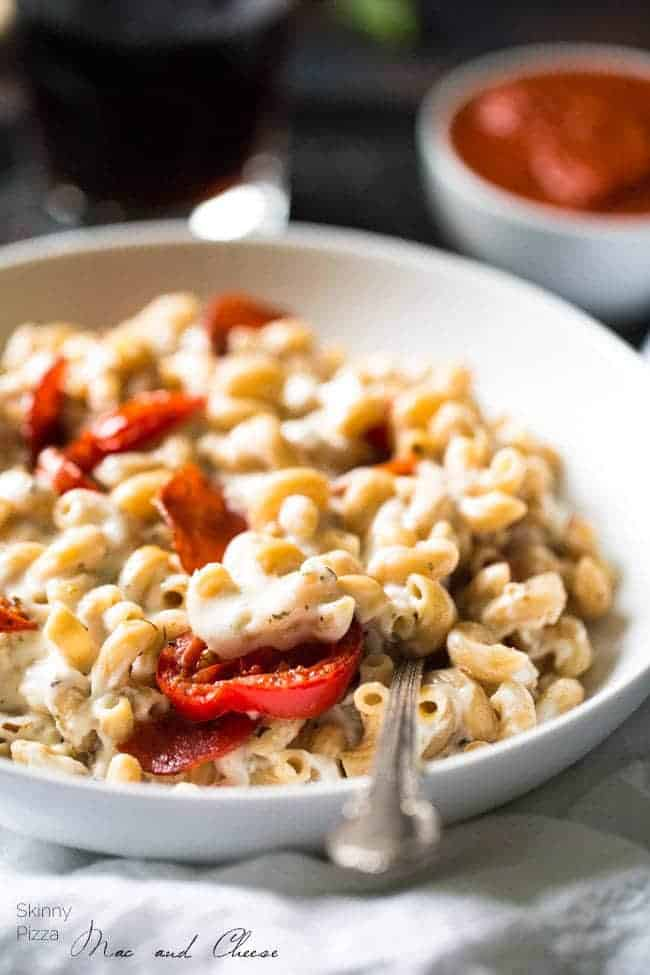 Skinny Pizza Mac and Cheese - Two comfort foods combined! This is SO quick, easy and delicious you would NEVER know that it's a healthy mac and cheese! | Foodfaithfitness.com | #recipe @FoodFaithFit