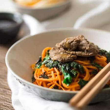 Spiralized Paleo Orange Beef Stir Fry with Kale and Sweet Potato Noodles - A healthy twist on takeout that is ready in 20 minutes! | Foodfaithfitness.com | @FoodFaithFit