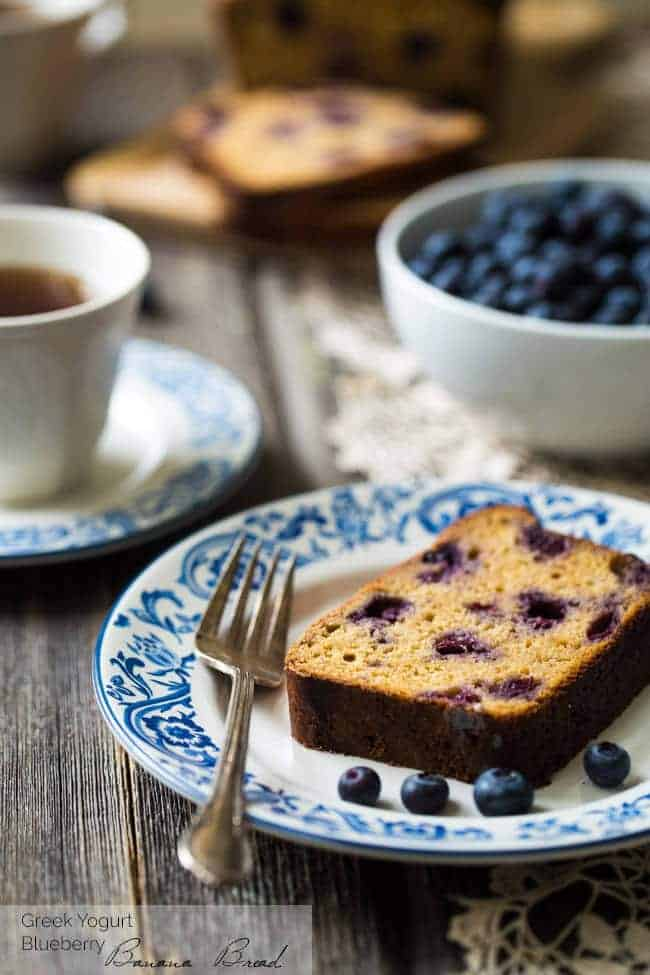 Whole Wheat Banana Bread with Blueberries - No refined sugar, no oil and made with Greek yogurt! This bread is SO good and SO easy! | Foodfaithfitness.com | @FoodFaithFit