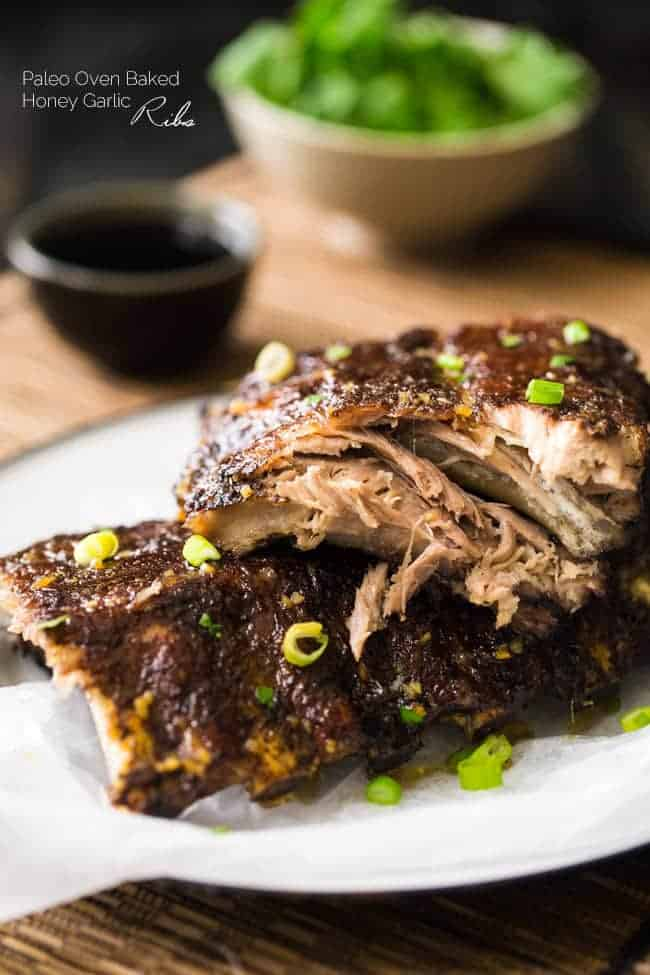 Paleo 5 Spice Honey Garlic Oven Baked Ribs - Sticky, sweet, healthier ribs that are gluten free, Paleo and made in the oven. These fall RIGHT OFF THE BONE!   Foodfaithfitness.com   @FoodFaithFit