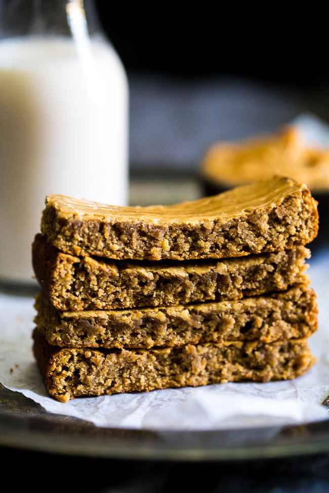 Paleo Almond Butter Homemade Protein Bars - 5 ingredients, one bowl and 20 minutes is all you need to make these soft and chewy bars! The a healthy, portable snack! | Foodfaithfitness.com | @FoodFaithFit