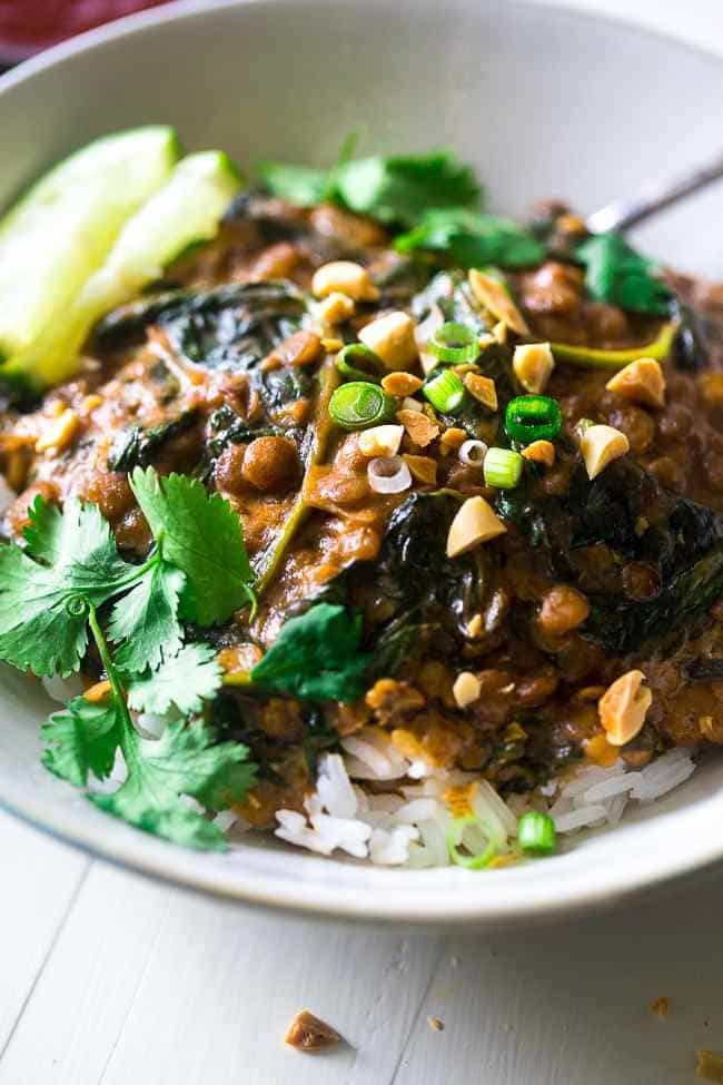 One-Pot Creamy Spinach Lentils - These Thai-style lentils are stewed in creamy peanut butter and coconut milk. They're a vegetarian, one pot wonder that is perfect for Meatless Monday! | Foodfaithfitness.com | @FoodFaithFit