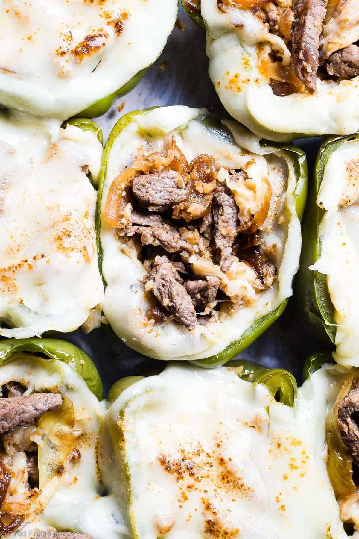 Low Carb Keto Philly Cheesesteak Stuffed Peppers - These stuffed peppershave all the flavors of your favorite sandwich in a healthy, low carb, easy weeknight meal that will please even picky eaters! Healthy comfort food at its best! | #Foodfaithfitness | #Glutenfree #Keto #Lowcarb #Healthy #Grainfree