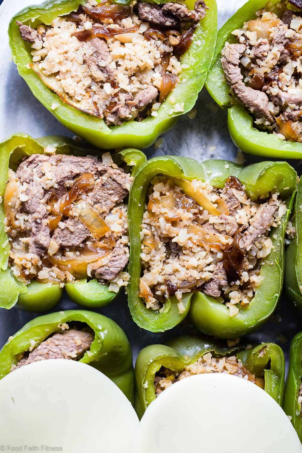 Low Carb Keto Philly Cheesesteak Stuffed Bell Peppers - These stuffed peppers have all the flavors of your favorite sandwich in a healthy, low carb, easy weeknight meal that will please even picky eaters! Healthy comfort food at its best! | #Foodfaithfitness | #Glutenfree #Keto #Lowcarb #Healthy #Grainfree