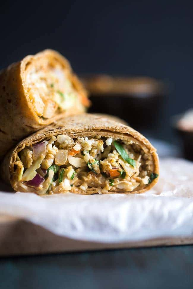 Skinny Thai Salad Wraps – A healthy, high-protein vegetarian wrap that is made with crunchy veggies, cauliflower rice and a low fat peanut sauce! A filling, easy meal for under 350 calories! | Foodfaithfitness.com | @FoodFaithFit