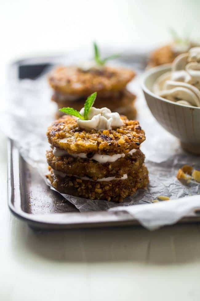 Macadamia Crusted Grilled Pineapple Stacks with Coconut Whipped Cream - Smokey-sweet grilled pineapple is crusted with macadamia nuts and then layered with coconut whipped cream for an easy, healthy, paleo-friendly dessert for Summer! | Foodfaithfitness.com | @FoodFaithFit