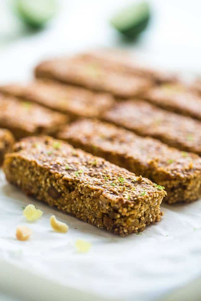 Tropical Chickpea & Quinoa Homemade Protein Bars - Quinoa, chickpeas, white chocolate, macadamia nuts, pineapple and fresh lime come together in these easy, gluten free and healthy snack bars that taste like summer!   Foodfaithfitness.com   @FoodFaithFit