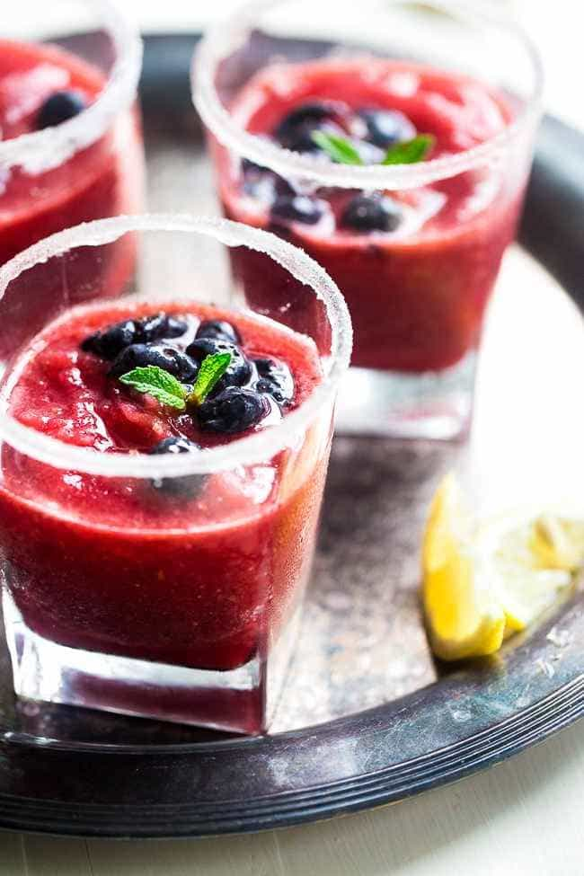 Skinny Blended Lemon Raspberry Mojito with Muddled Blueberries - Thick, frosty and SO refreshing for only 115 calories! Skinny summer drinking at it's best! | Foodfaithfitness.com | @FoodFaithFit