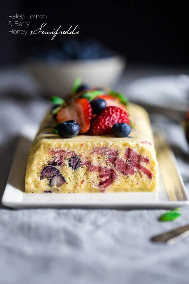 Paleo Red, White and Blueberry Lemon Honey Semifreddo Recipe - This frozen, mousse-like dessert uses honey and coconut milk to make it healthy, and only 160 calories a slice! It's loaded with berries and is creamy and refreshing! Perfect for July 4th! | Foodfaithfitness.com | @FoodFaithFit