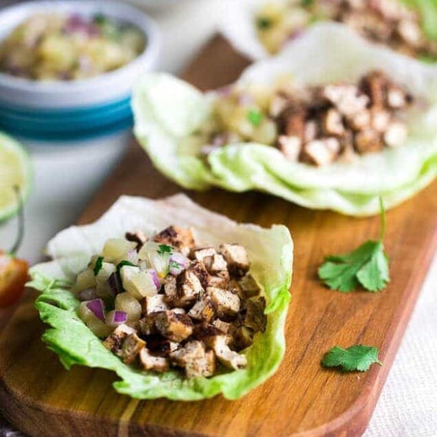 Vegetarian Lettuce Wraps with Jerk Grilled Tofu - These lettuce wraps are piled with spicy-sweet and crispy grilled tofu and pineapple salsa. They're a quick and easy, healthy meal for Summer grilling or Meatless Monday! | Foodfaithfitness.com | @FoodFaithFit